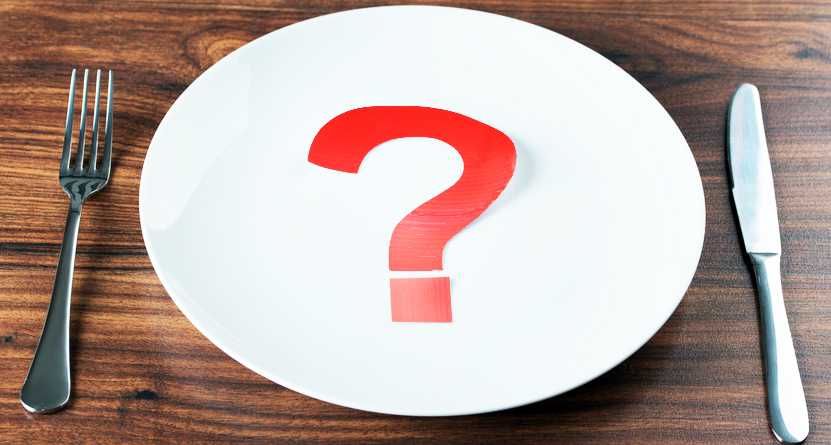 Red Question Mark On White Plate With Fork And Knife Over Desk